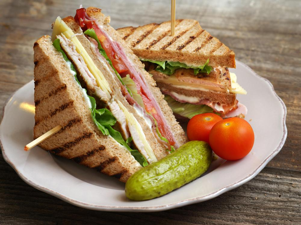 Pre-made, wrapped club sandwiches and pickles are a good picnic option.