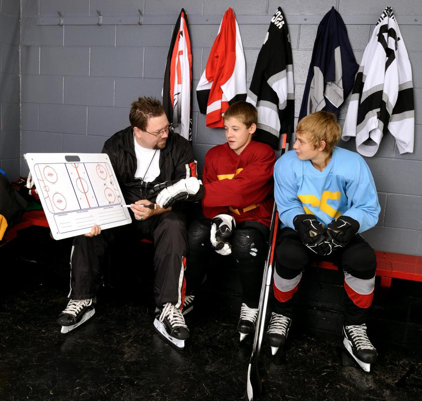 Ice hockey coaches can teach youth positioning and team skills as well as how to skate, shoot and bodycheck.