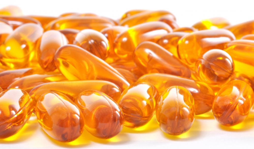 Helpful for regulating cholesterol levels, fish oil supplements are rich in healthy fats, such as omega-3 fatty acids, eicosapentaenoic acid and docosahexaenoic acid, commonly called DHA.