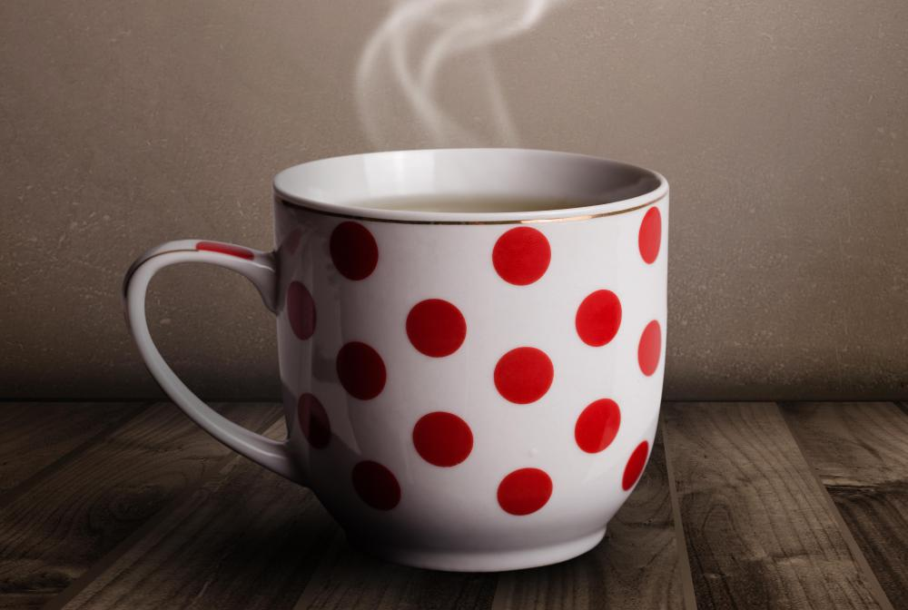 People can easily get burned if they knock over a mug of hot coffee.