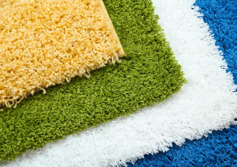A carpet installer may lay carpet in both businesses and homes.