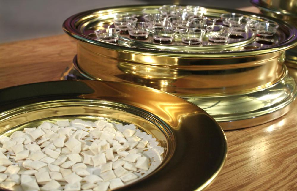 Communion wafers and wine, which are symbols of Christ's body and blood.