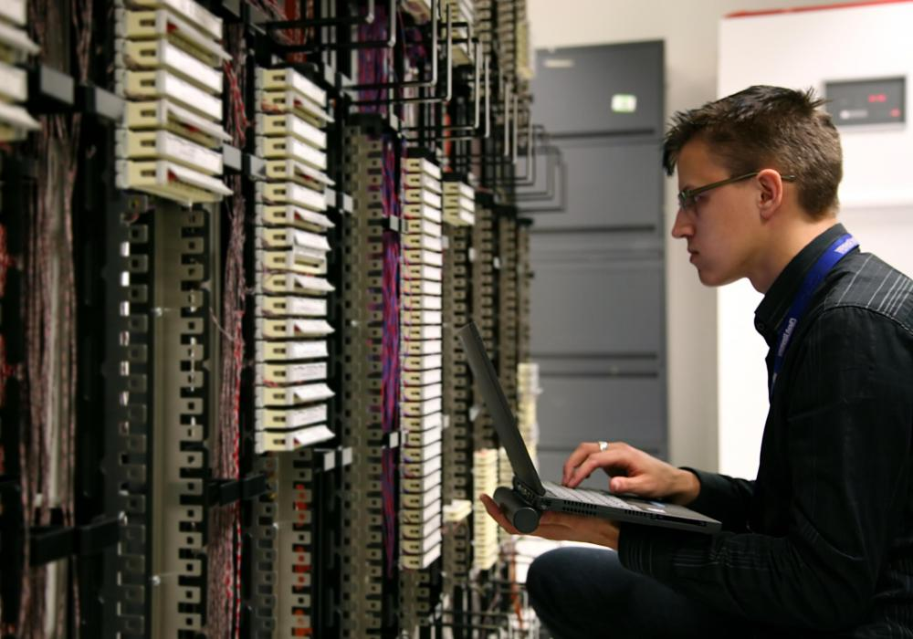 A network security analyst reviews computer networks to determine if they are protected from cyber threats.