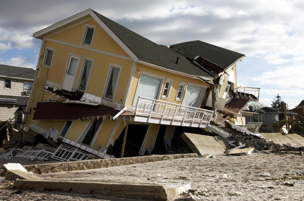 Insurance agents help people file claims following a disaster.