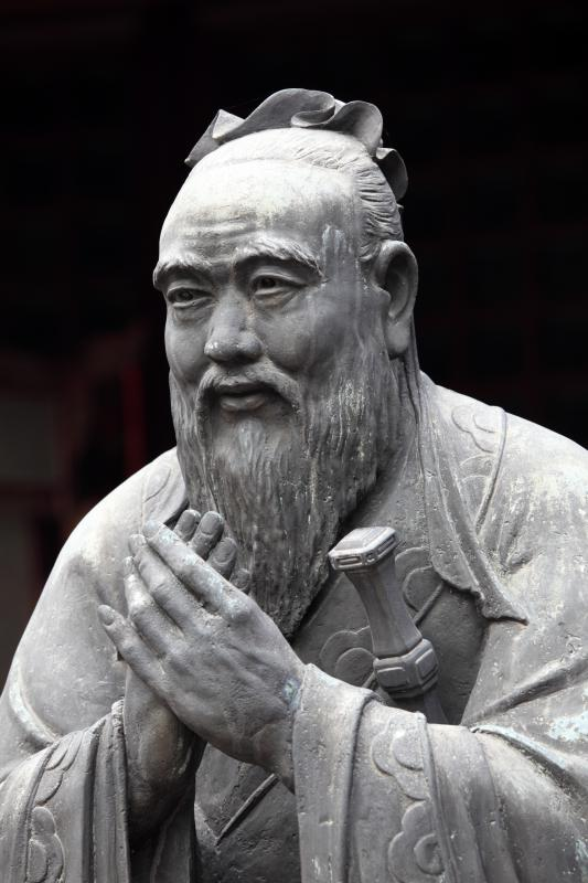 "A statue of Confucius, who is credited with the saying ""Do not do to others that which we do not want them to do to us.""."