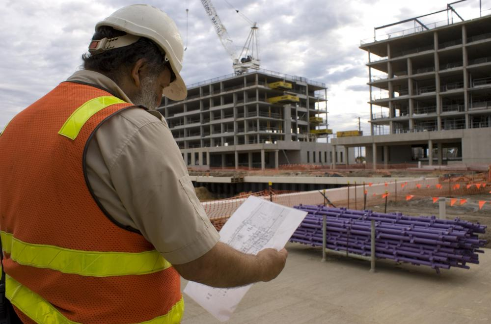 A construction supervisor inspects finished jobs.