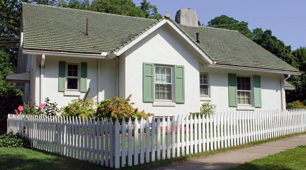 Some backyard cottages can resemble a miniature farmhouse.