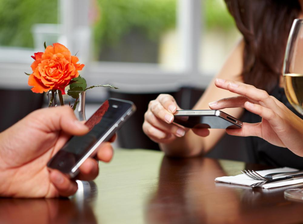 Texting while on a date or talking with others can be considered bad etiquette.