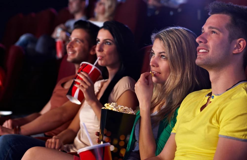 Movie theaters typically offer snack bars so that patrons can nibble while watching a film.