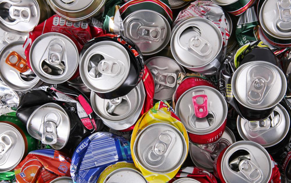 Aluminum soda cans can be recycled at a scrap metal center.