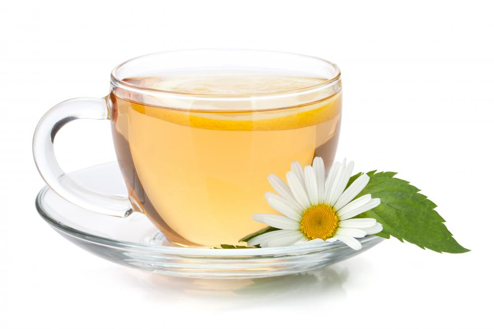 Chamomile tea is a natural remedy for puffy eyes, which should be closed during application.