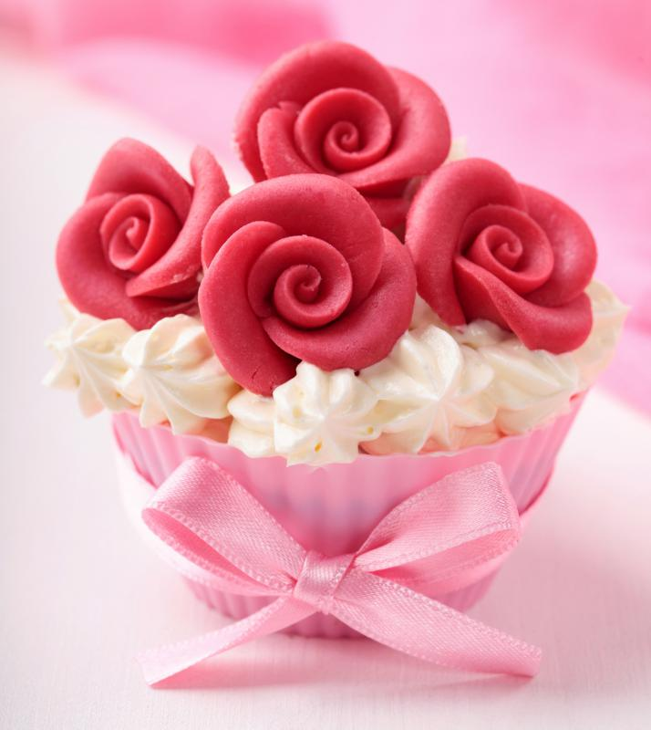 A cupcake decorated with marzipan roses.