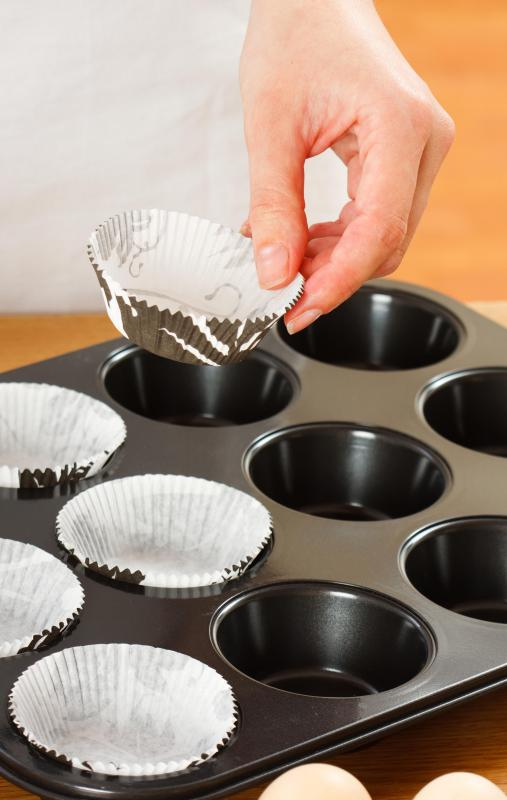 A child as young as 3 might be able to line cupcake pans with paper liners.