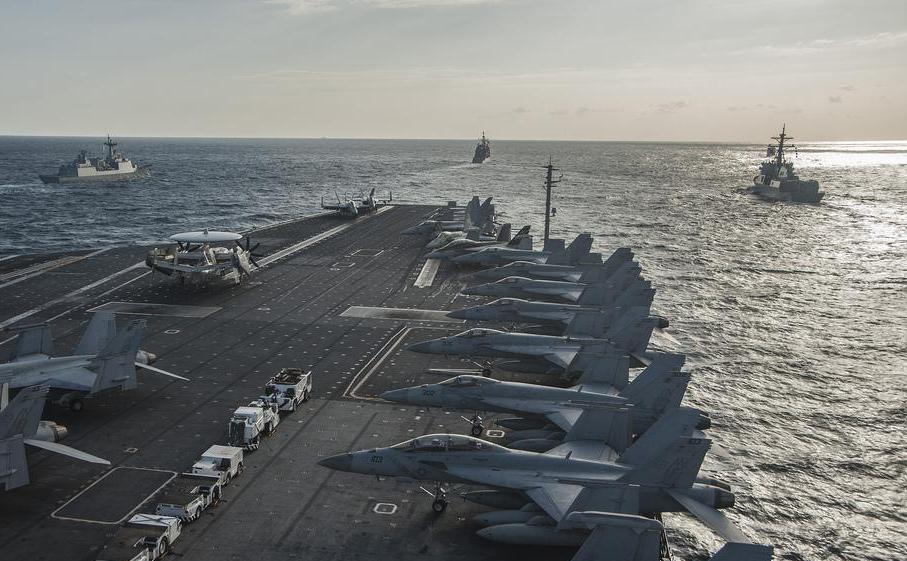 Aircraft carriers are an example of heavy military equipment.