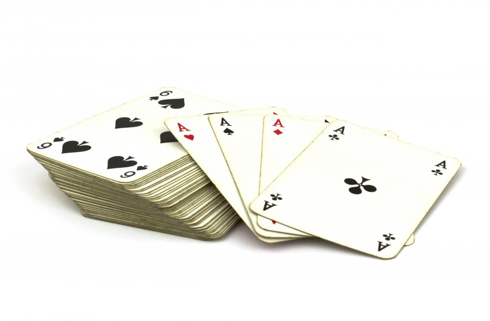 Playing 52 card pick-up could involve purposely dropping a deck of cards and having a person pick all 52 cards off the ground.