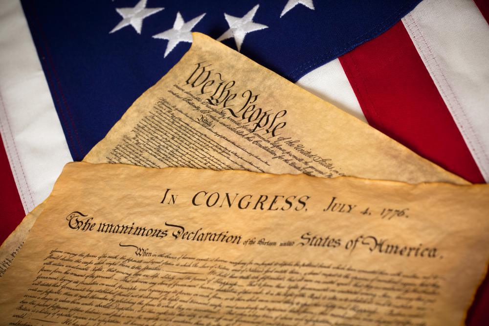 The Declaration of Independence asserted America's separation from Great Britain, and the Constitution ensured the new government would be different.