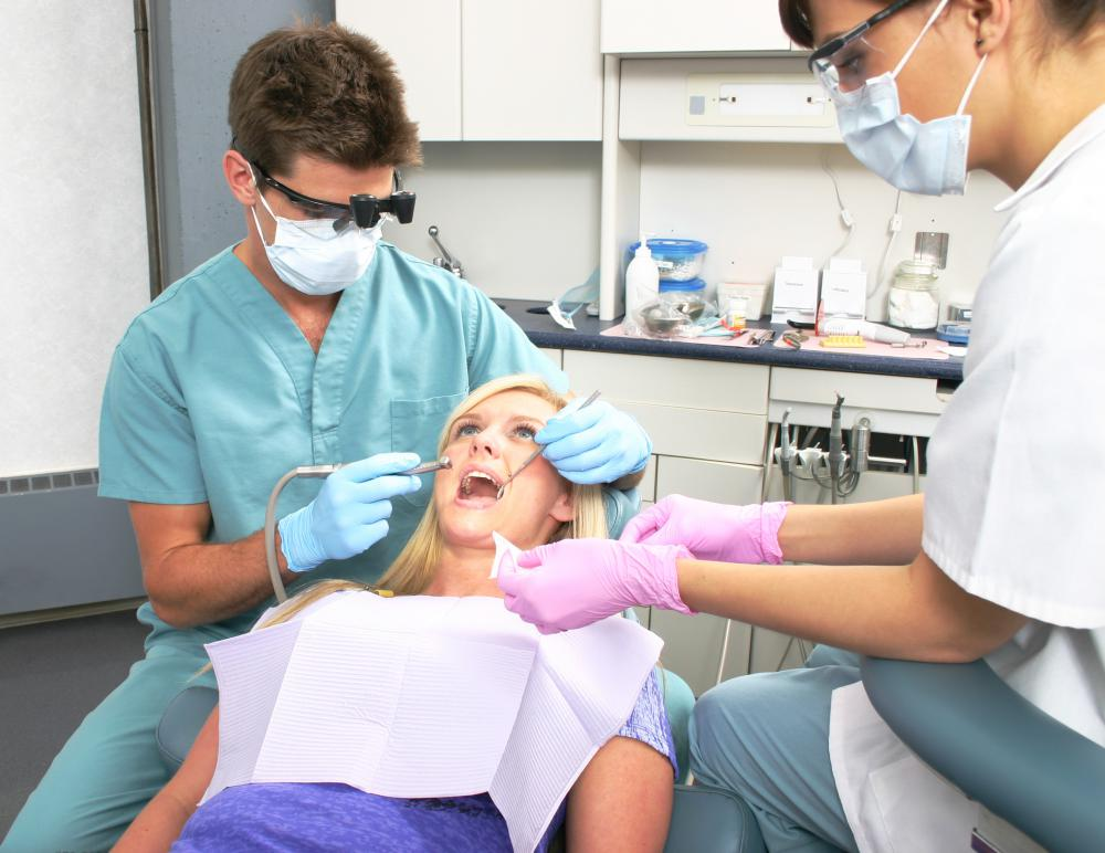 A woman getting a dental cleaning, which can help prevent gingivitis.