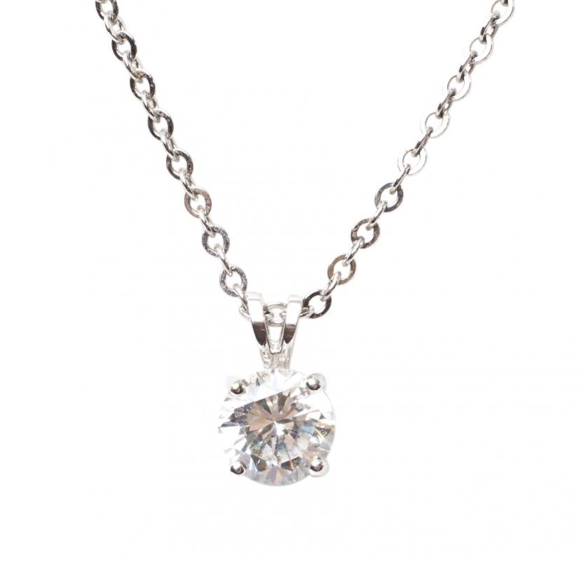 A solitaire diamond necklace may be worn with semi-formal attire.