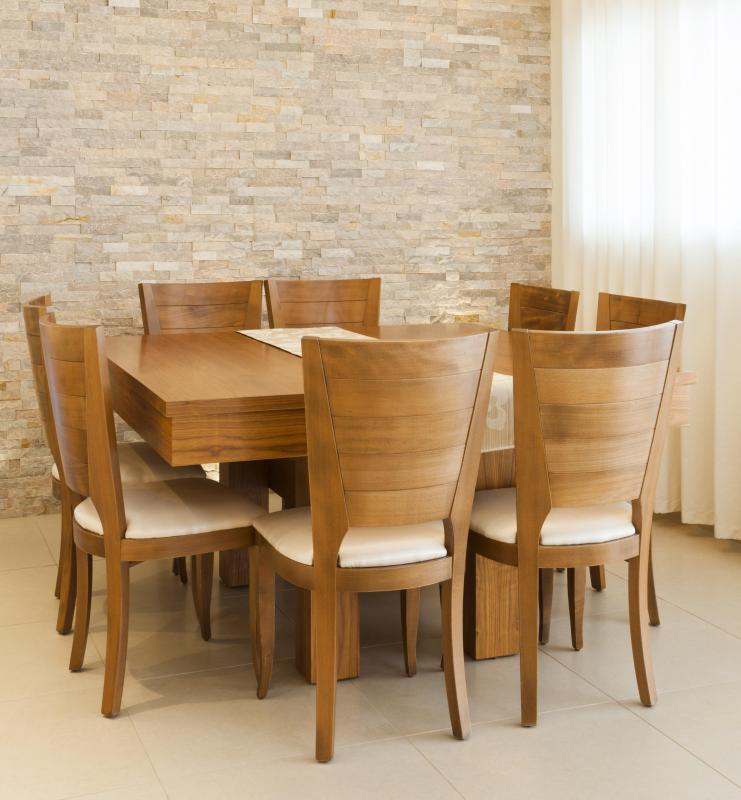 Some furniture, like a dining room table set, is made from faux wood with a veneer covering.