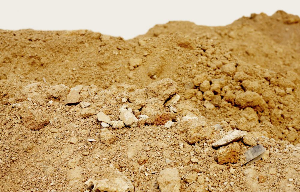 Fill dirt is found under topsoil and contains clay, sand, and other materials.