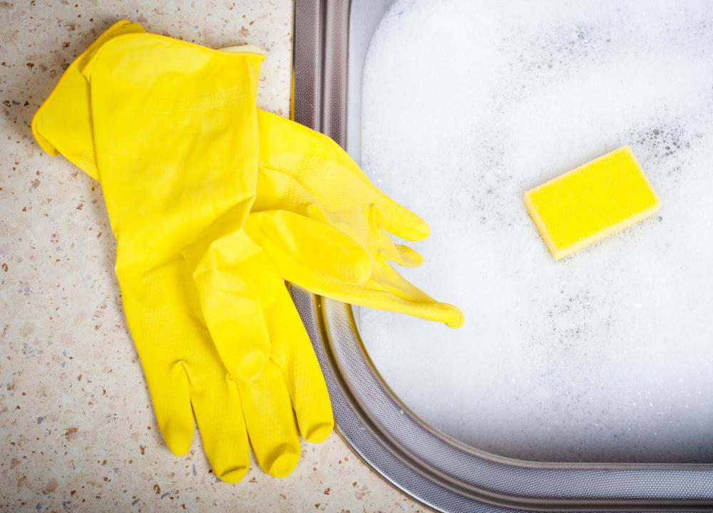 Wearing rubber gloves while washing dishes will help keep hands from drying out.
