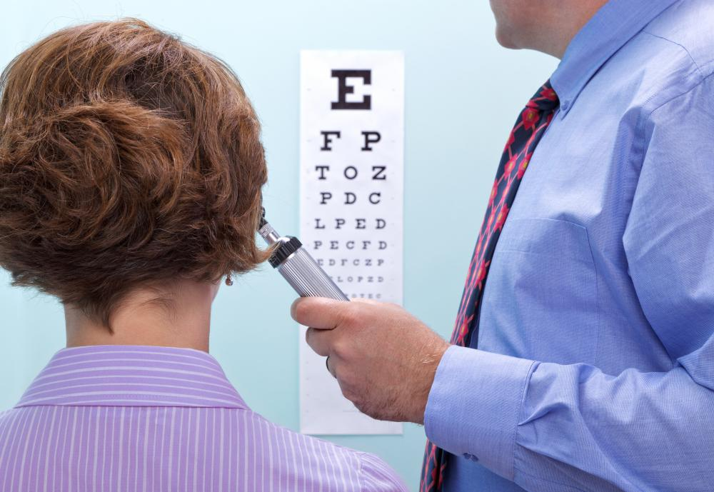 A doctor uses a wall chart to test a patient's visual acuity.