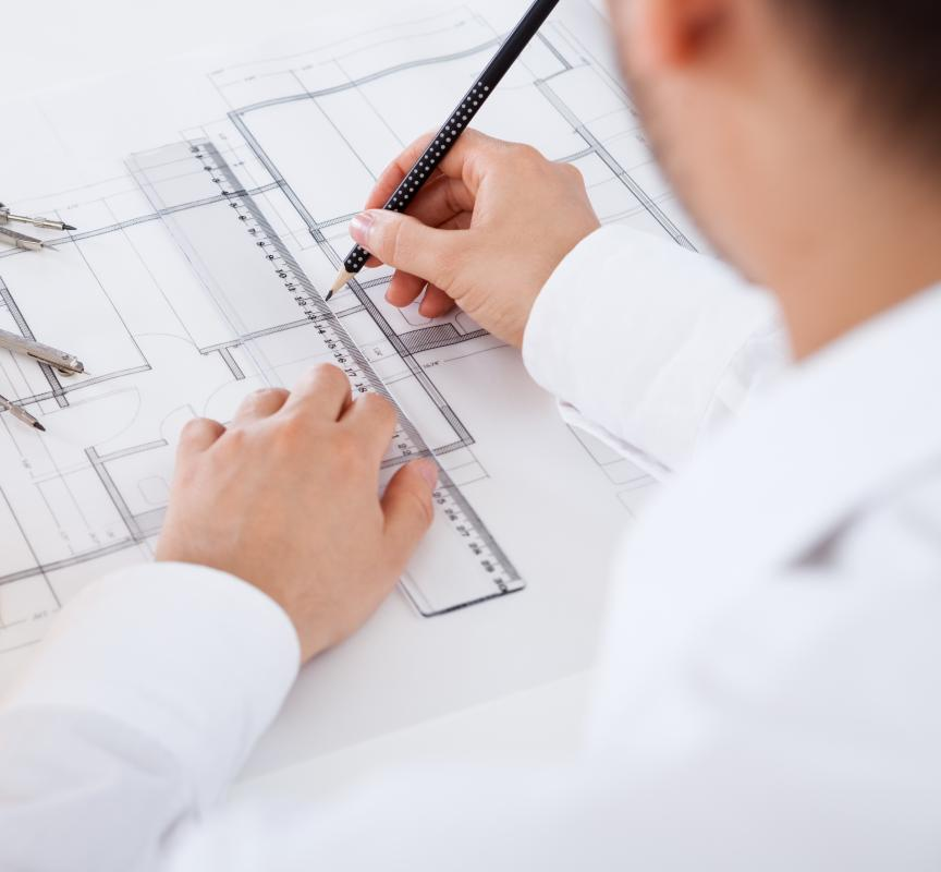 A draftsman makes technical drawings such as blueprints by hand.