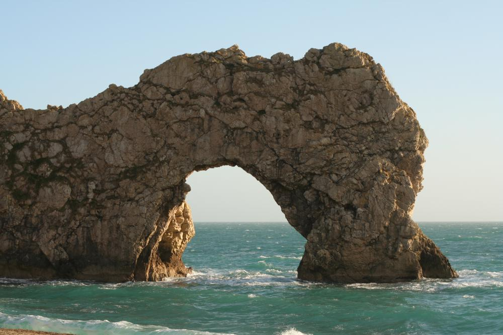 The Durdle Door sea arch formed as the ocean eroded limestone along the coast of southern England.