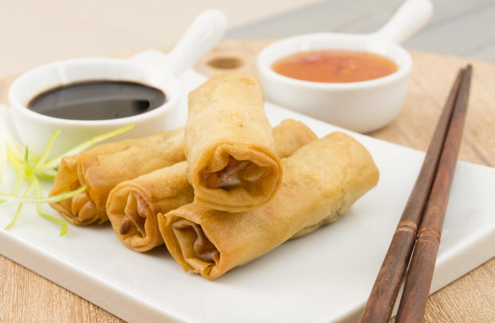 Spring rolls are popular Asian appetizers containing various meats and vegetables.