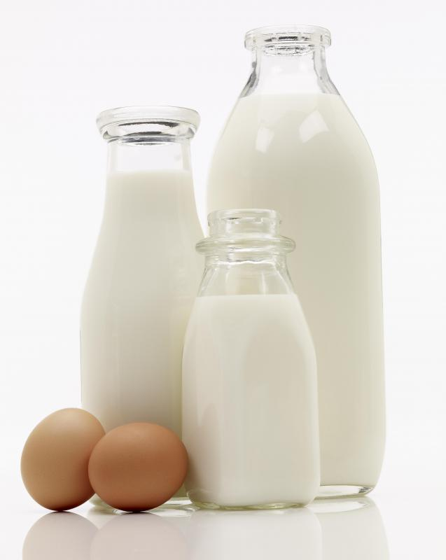 Milk and eggs, which are both used to make protein shake powder.