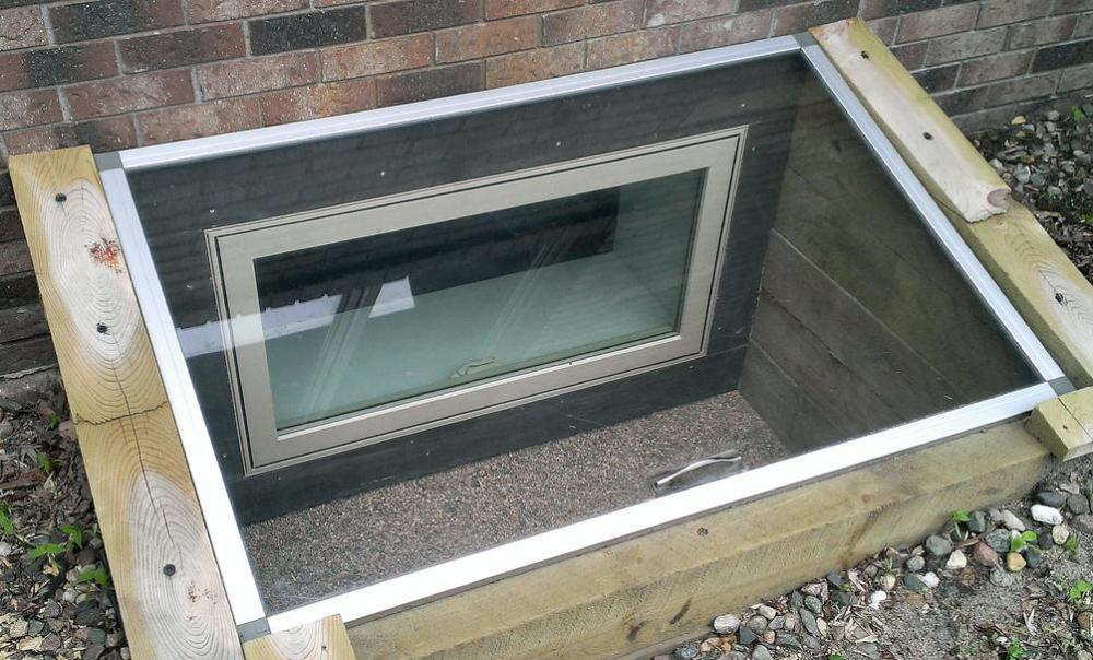 An egress well is a basement window enclosure that surrounds a low-level window.