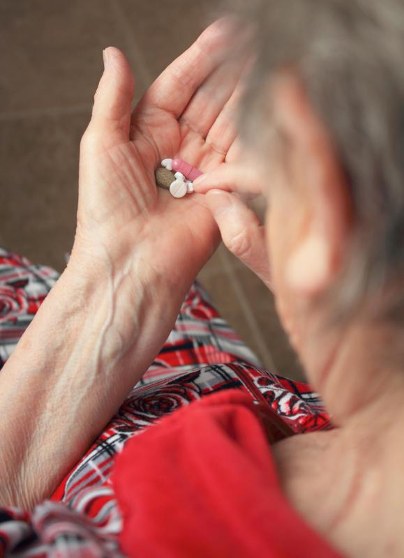 A nurse case manager may visit elderly patients to ensure that they are complying with their medication regimen.