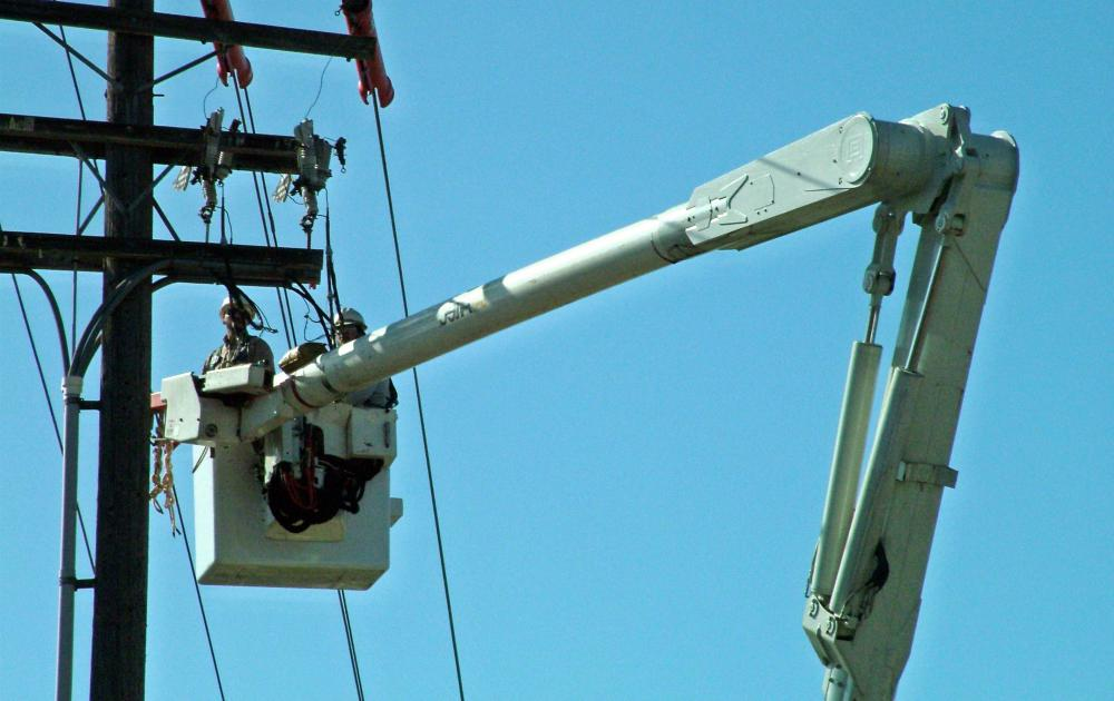 Electric and phone companies often use boom trucks to work on aerial wires.