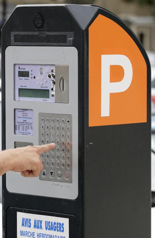 Parking enforcement officers may read and collect money from parking meters.