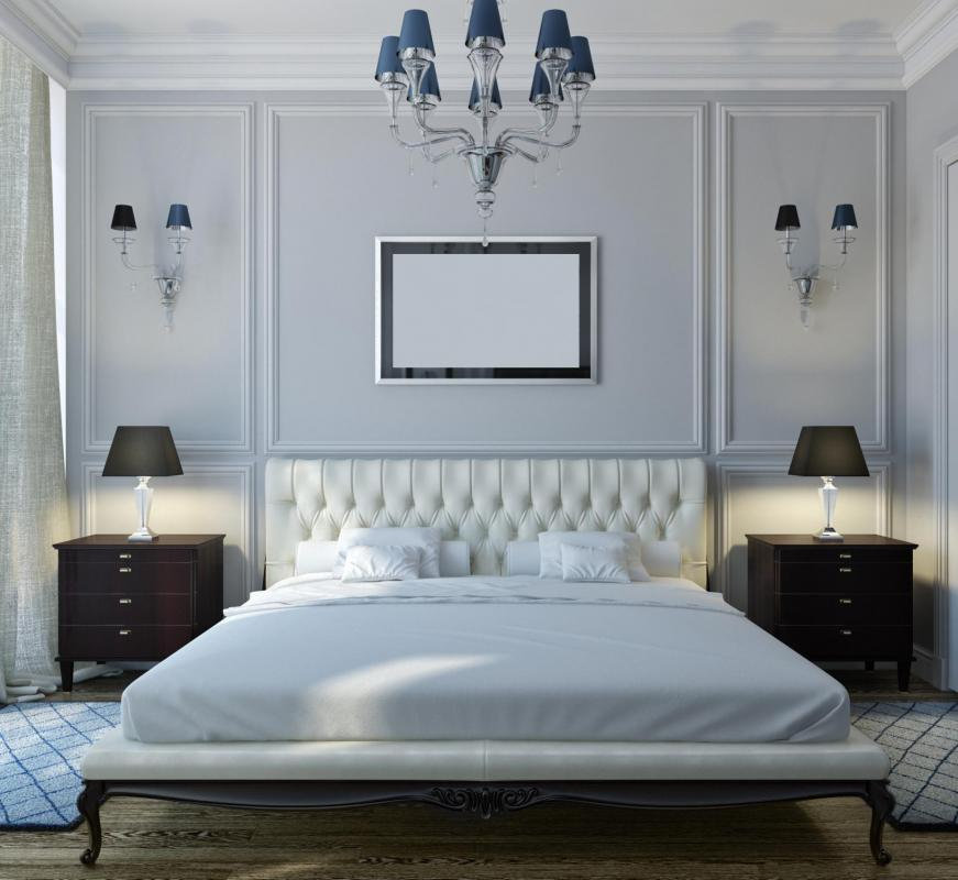 small chandeliers and matching wall lighting can be used in modern bedroom layouts