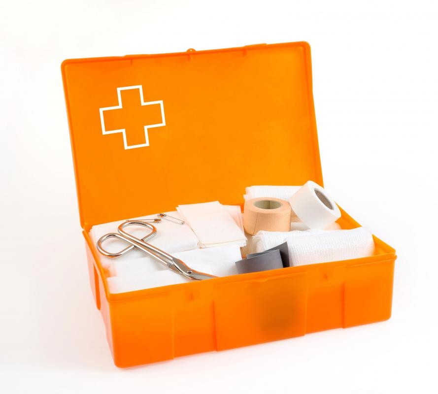a first aid kit should be stocked with items like gauze antibacterial cream bandages scissors and alcohol wipes