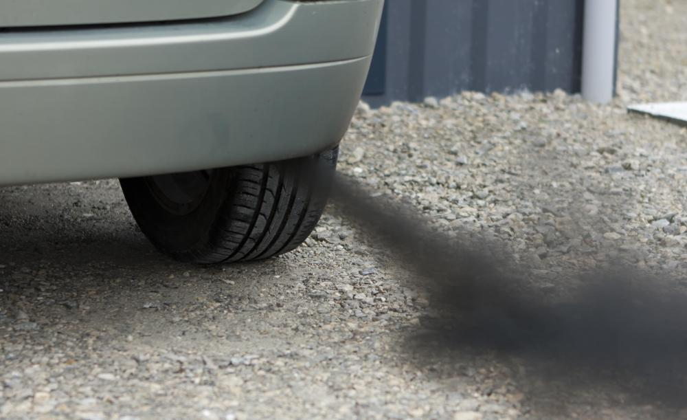 A car's emissions report states whether or not the car is releasing a large amount of pollutants into the air.