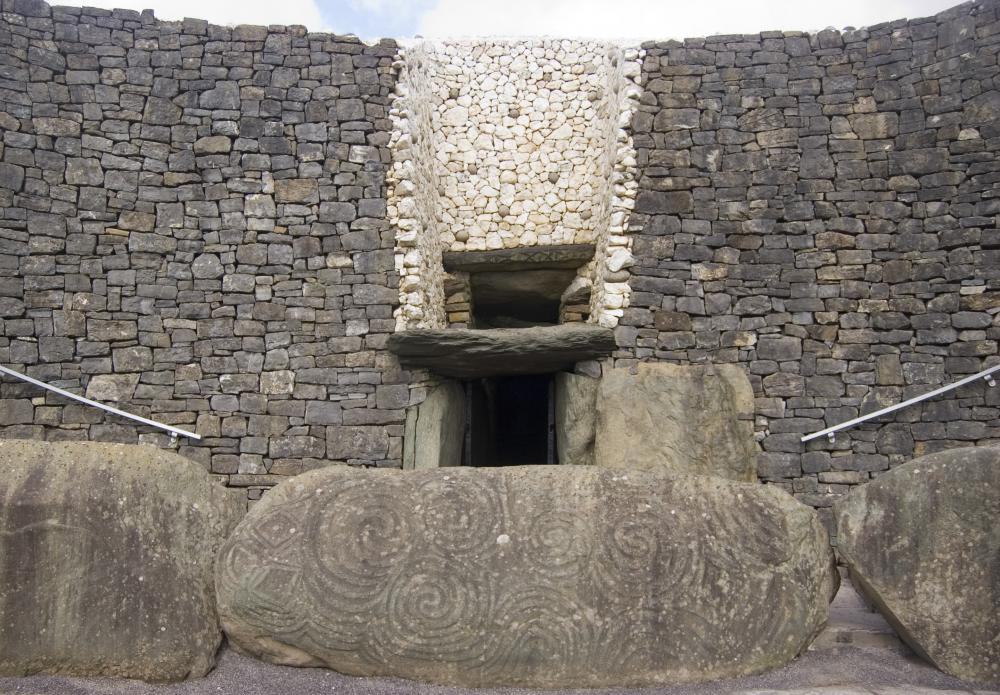 The neolithic tombs at Newgrange are a popular tourism spot in Ireland.