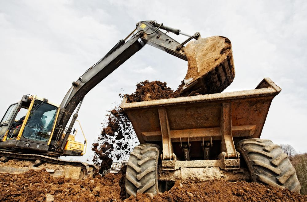 Excavation machines may be used to remove natural materials like dirt or stone from a site, typically during construction.