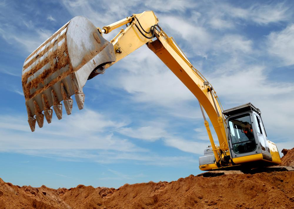 The bucket of an excavator, which is attached to the end of its boom, or 'arm', is used to dislodge and move earth.