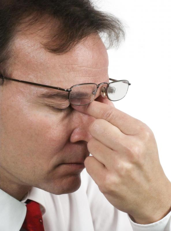 A software engineer may experience chronic eye strain from computer work.