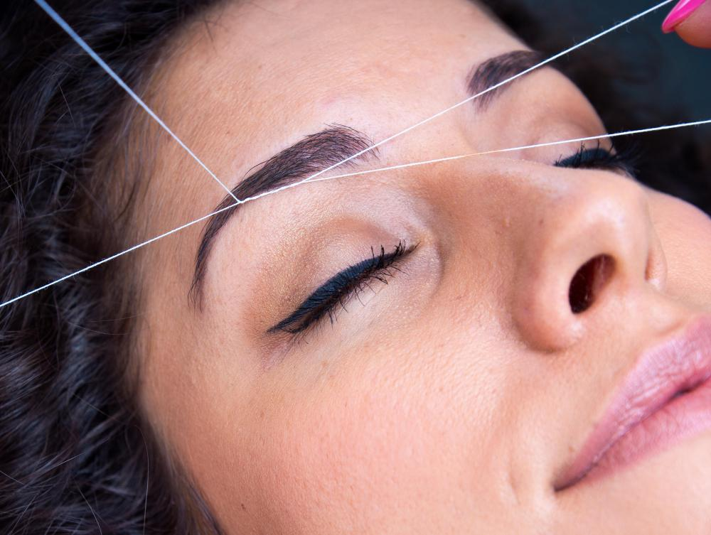 Threading is a popular shaping technique for grooming the eyebrows.