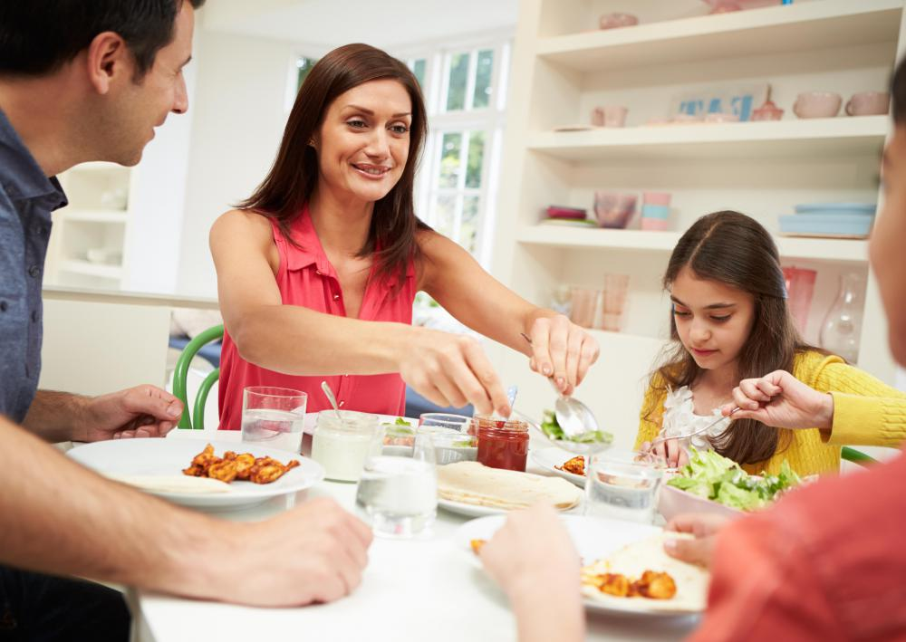 Sitting down together to share feelings over a meal is one family therapy technique.