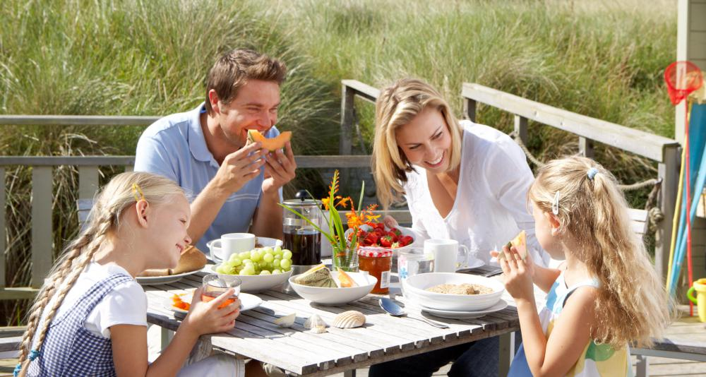 Parents can help their children develop good table manners at regular family meals.