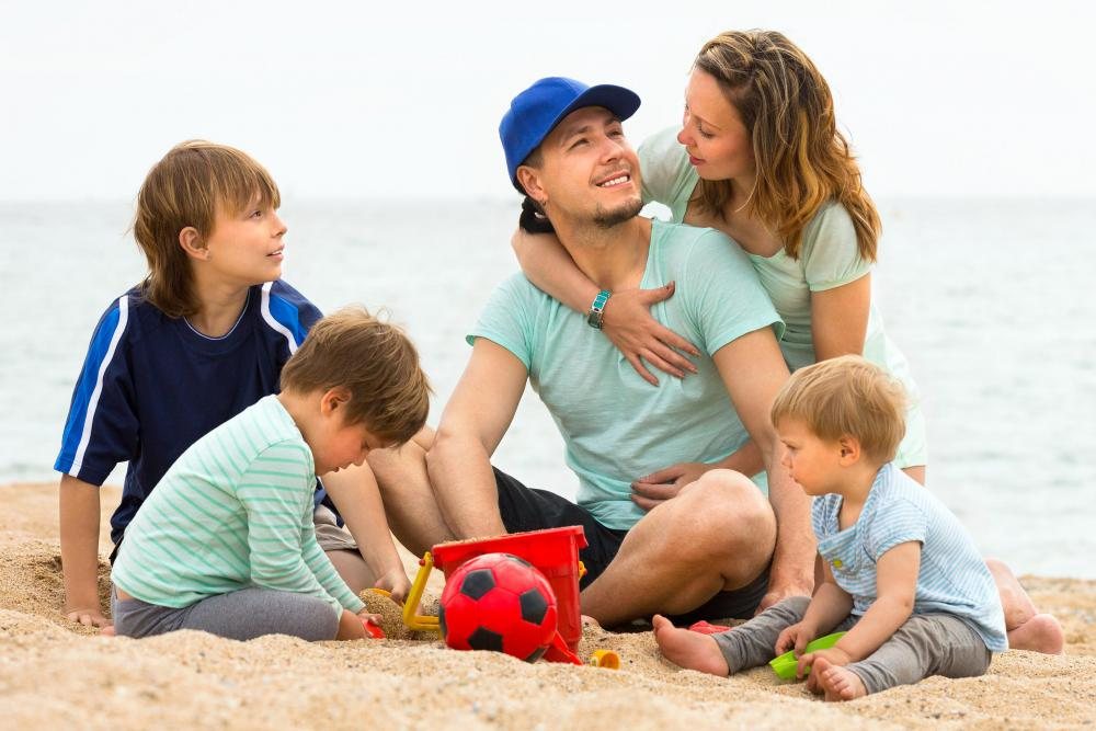 A day at the beach is a relatively inexpensive way for families to spend time together.