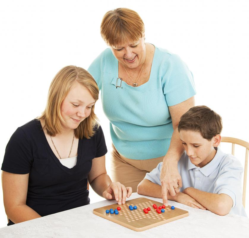 An activities assistant may play board games with patients.