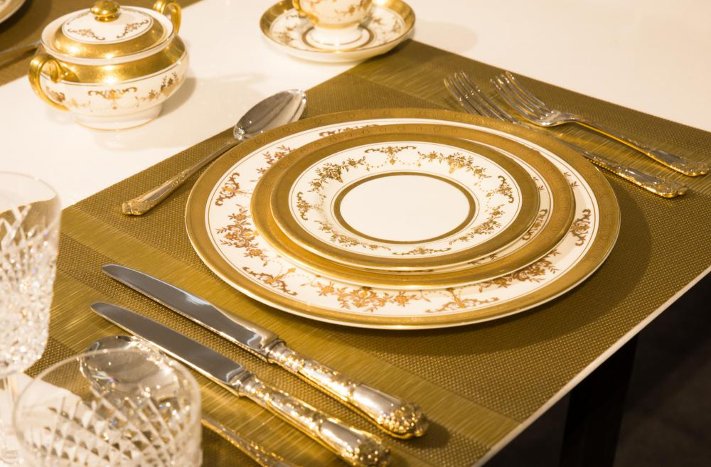 A charger plate was once considered an essential piece for any formal table setting. & What is a Decorative Charger Plate? (with pictures)