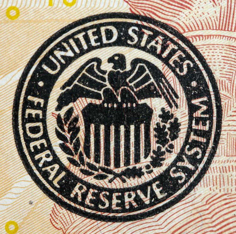 In the United States, the federal reserve regulates the amount of bank notes that are issued.