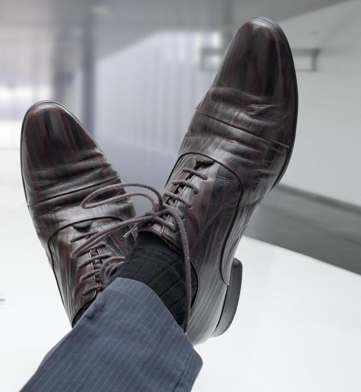 Dark shoes and socks should be worn with a suit of a similar tone.