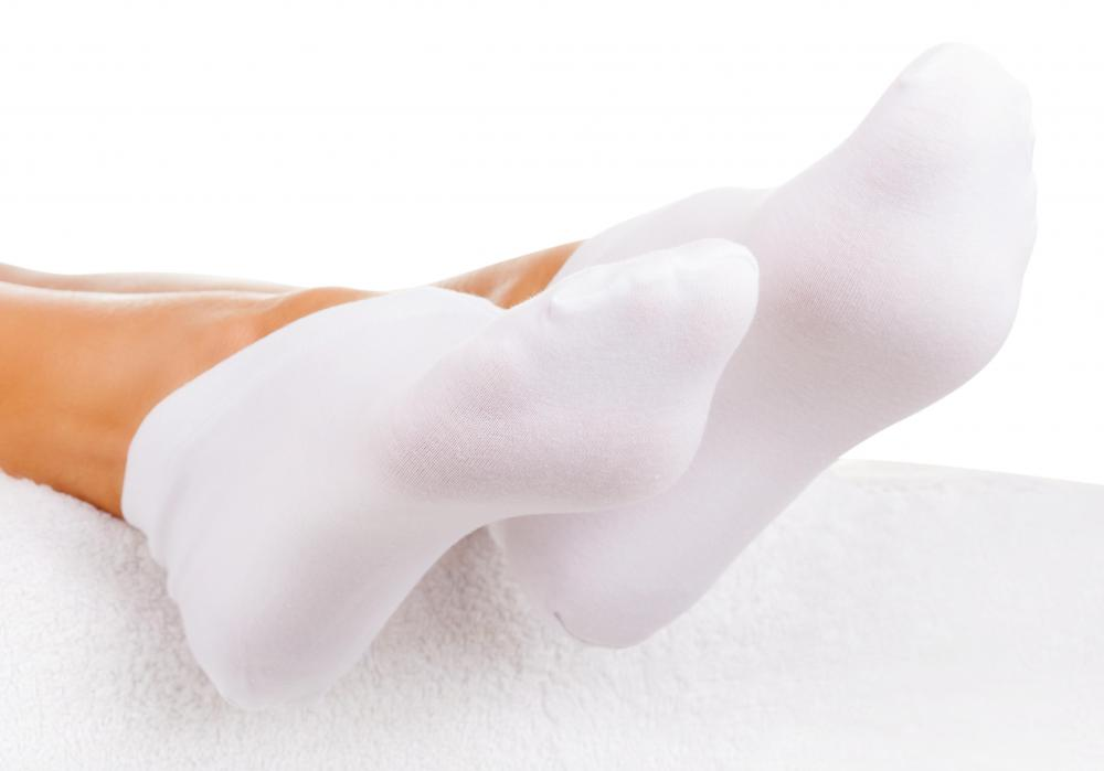 Wear a pair of socks to keep the feet dry if the cuticle infection is on the foot.